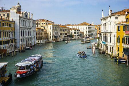 VENICE, ITALY - OCTOBER 12, 2019: View at boats in canal at Venice, Italy. Venice is one of the top tourist destinations in the world with estimated 25 million tourists each year. Publikacyjne