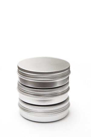Lip balm in the round metallic tins isolated on the white background