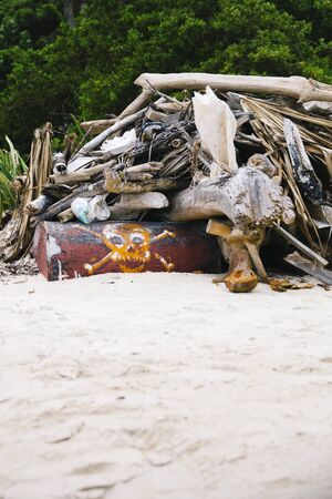 Garbage on the tropical beach as environmental pollution concept
