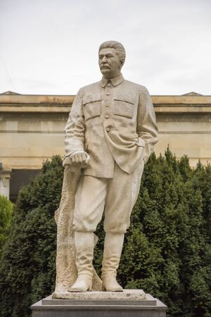 GORI, GEORGIA - MAY 2, 2019: Statue in front of Stalin museum in Gori, Georgia. Museum is dedicated to the life of Soviet leader Joseph Stalin, who was born in Gori.