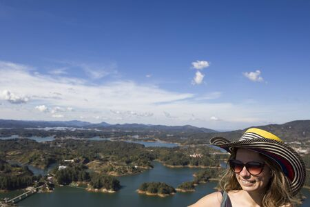 Viewat young woman at Guatape lake in Antioquia, Colombia 版權商用圖片