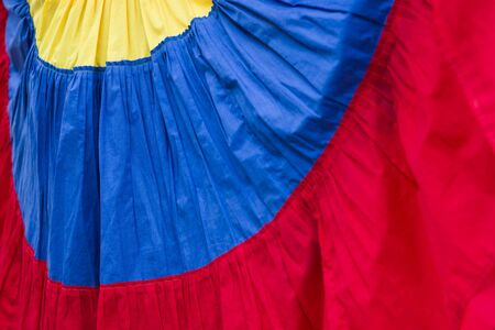 Closeup detail of Palenquera, fruit seller, dress in the colors of Colombian flag