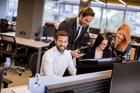 Group of young business people are working together with laptop