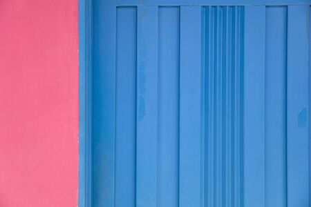 Closeup of the pink and blue wall texture Imagens