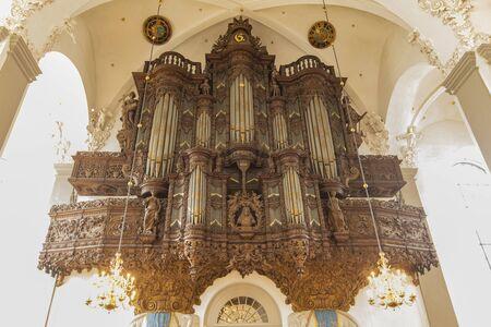 COPENHAGEN, DENMARK - JUNE 14, 2018: View at Organ in the Trinitatis Church in Copenhagen, Denmark. It is an Parish Church built at 1651.