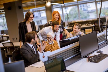 Senior businesswoman working together with young business people in the modern office