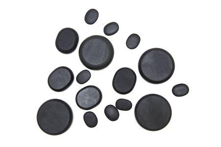 Volcanic hot stone massage stones on the white background Stock Photo