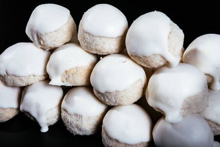 Small round coconut biscuits on the dark background Фото со стока