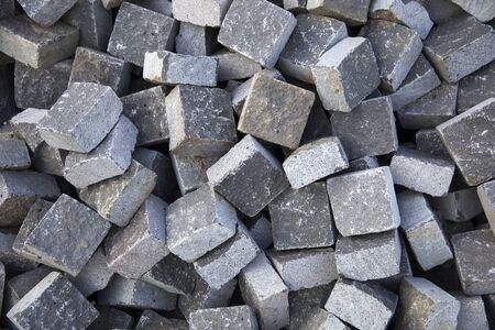 Heap of granite stone blocks prepared for paving the street Stok Fotoğraf