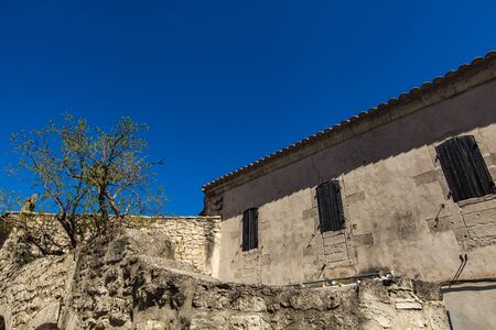 Detail of old building in French village Les-Baux-de-Provence in South France