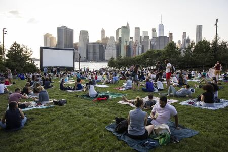 NEW YORK, USA - AUGUST 25, 2017: Unidentified people at Brooklyn Bridge Park free outdoor movies projection in New York. Move projections, named Movies With A View, launched at 2000.