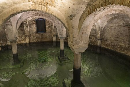 RAVENNA, ITALY - FEBRUARY 16, 2018: Crypt under water in Basilica of San Francesco at Ravenna, Italy. It is irst build in 450 and it is a major church in Ravenna. 報道画像