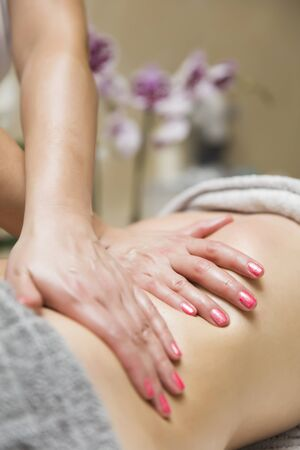 Woman having an professional massage of the abdomen in the spa center