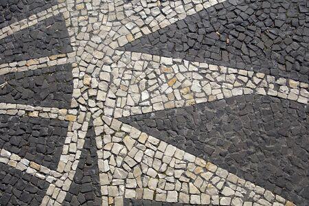 Closeup surface of the blocky pattern old stone pavement Standard-Bild