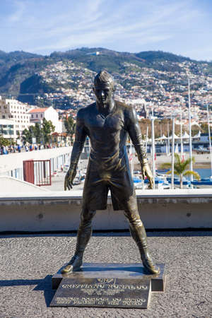 FEBRUARY 9, 2020: Christiano Ronaldo Statue in Funchal at Madeira Island, Portugal. Statue of famous Madeiran football player was created by sculptor Ricardo Velosa in 2014.