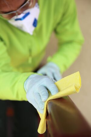 Closeup of deep cleaning of surface with alcohol for virus desease prevention