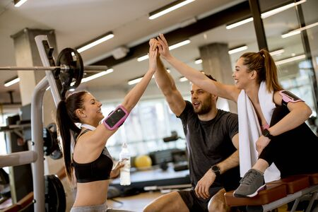 Cheerful young fit fitness team in the gym Reklamní fotografie