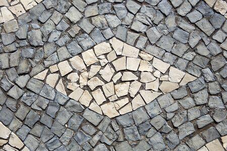 Closeup surface of the blocky pattern old stone pavement Foto de archivo