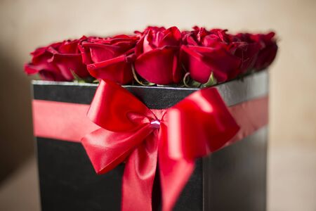 Closeup of the box full of red roses
