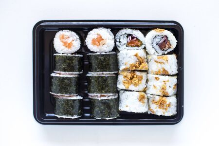 Fresh made sushi maki and crispy rolls on the plate Stock Photo
