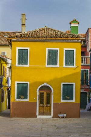 View at traditional brightly colored house on Burano island, Italy Stok Fotoğraf - 148178930