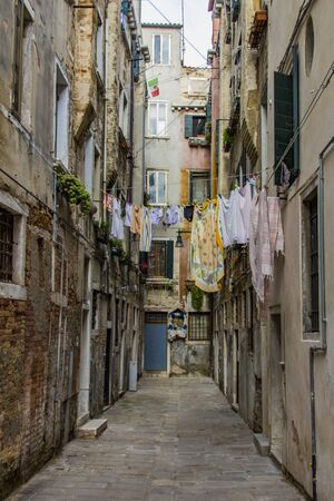View at clothes hanging on a clothesline in a narrow street in Venice, Italy