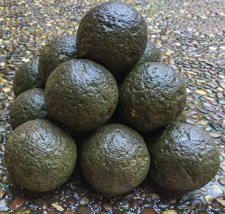 Old stone cannon balls in the coutyard of Castle Estense, Ferrara