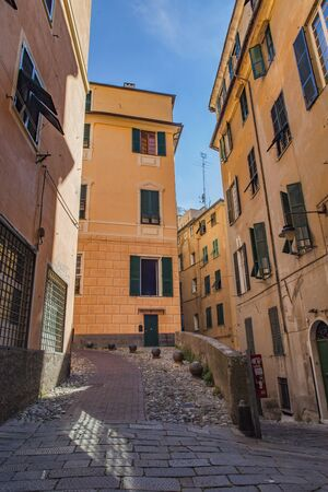 View at narrow street in the historic center of Genoa, Italy