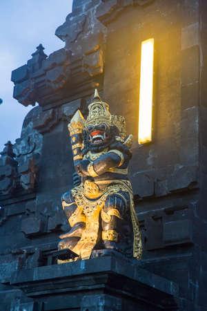 Statue at Hindu pilgrimage temple Pura Tanah Lot on Bali island, Indonesia