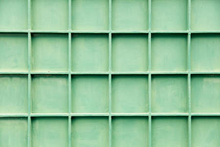Old green metal cell panels texture close up