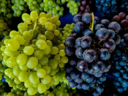 Bunch of different types of fresh grapes on the market Stock Photo