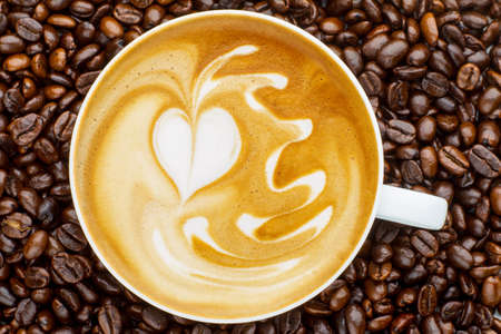 latte art: Latte art, coffee in coffee beans background Stock Photo