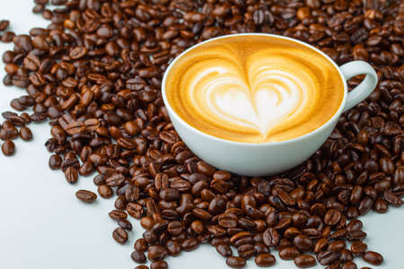 Latte art, coffee in coffee beans background photo
