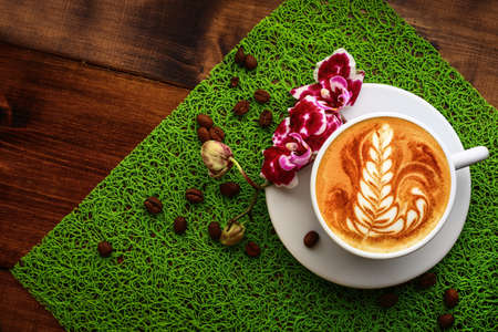 cappuccino cup: cup of cappuccino on a green table Stock Photo