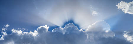 Sun shining through the heavenly beautiful clouds in the sky
