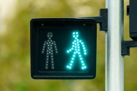 Pedestrian traffic light with green light lit