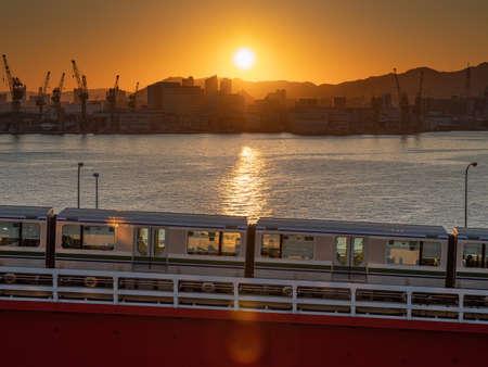 Red kobe port monorail bridge at sunset twilight in Kobe Hyogo Japan