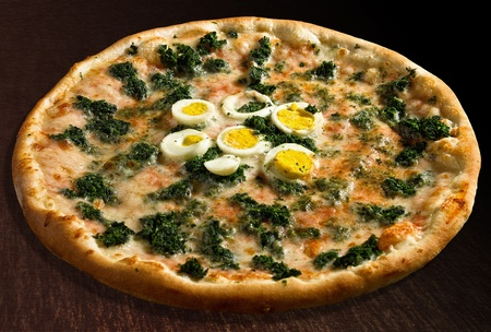 Pizza  spinaci with eggs and spinach - isolated Stock Photo - 13179614