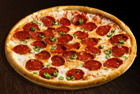 Pizza diavola with pepperoni and pimento - isolated