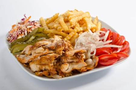Doner kebab on a plate with french fries and salad Standard-Bild