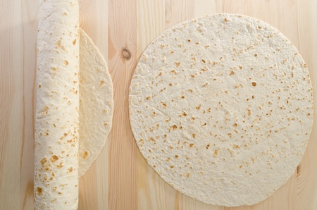 Pita bread on kitchen wooden plank photo