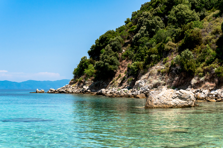 Exotic blue sea lagoon at Greece, mount Athos in the background