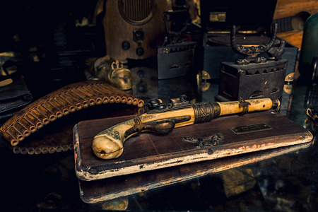 Ivory pistol with a grunge decor Standard-Bild
