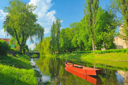 narew: Spring landscape with boat on the Narew river. Pułtusk, Poland.