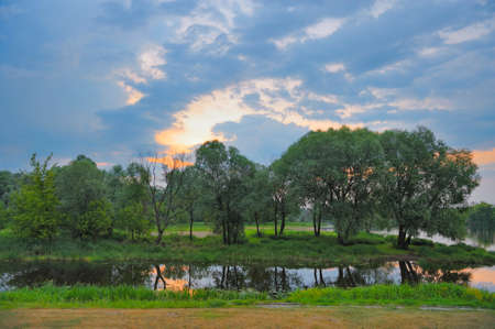 Twilight spring landscape with flood waters. photo