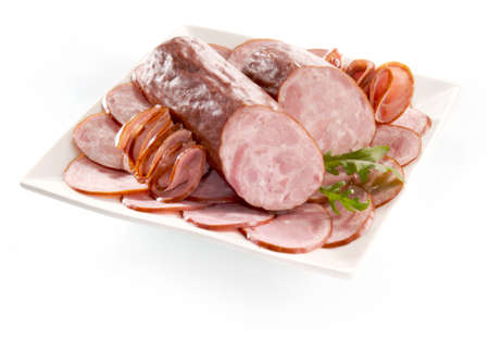 Dried sausage isolated on white background photo
