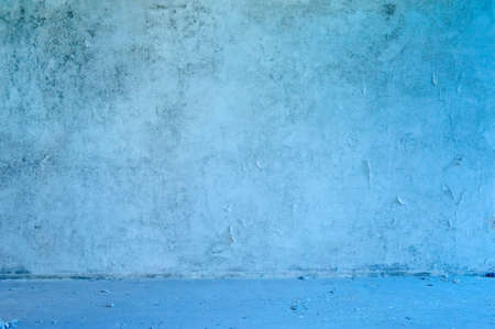 Old abandoned grungy blue wall