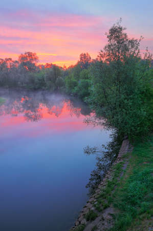 narew: The morning landscape with fog and warm pink sky over the Narew river, Poland