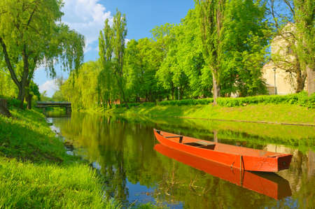spring landscape: Boat on the river  Spring landscape  Stock Photo