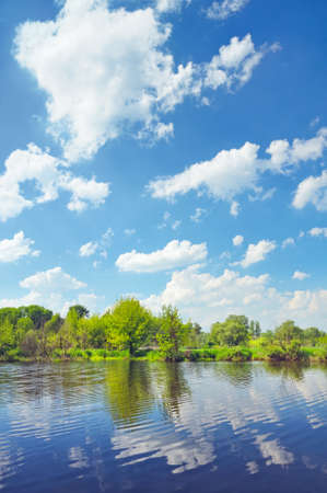 narew: Cloudy landscape with flood waters of Narew river in Poland